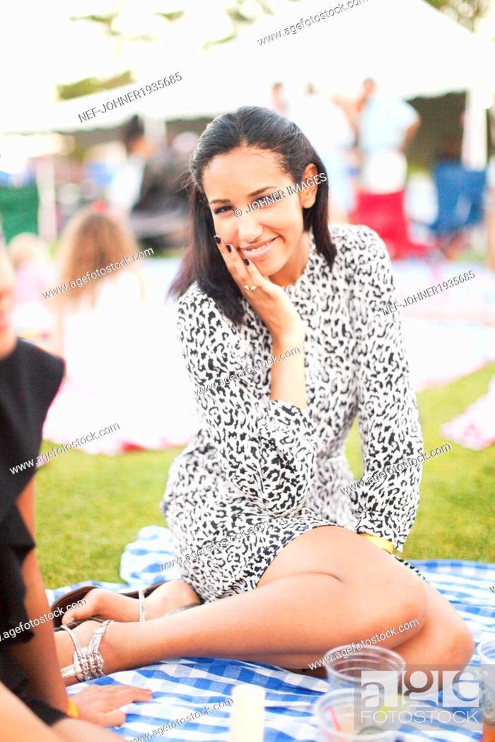 Stock Photo: Young smiling at picnic, New York city, USA.