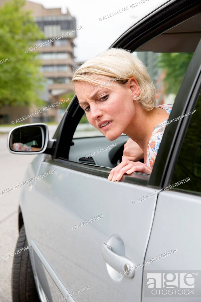 Stock Photo: Female car driver parks her car.