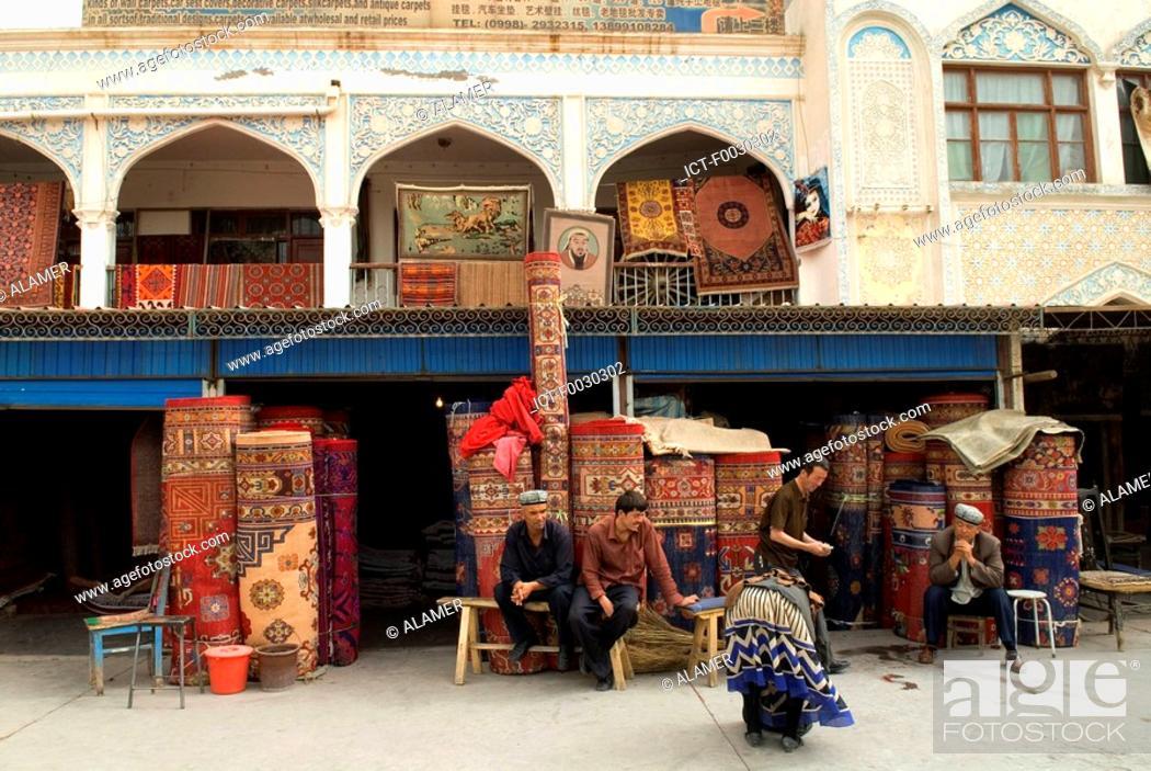 Stock Photo: China, Xinjiang, kashgar, carpets merchant.