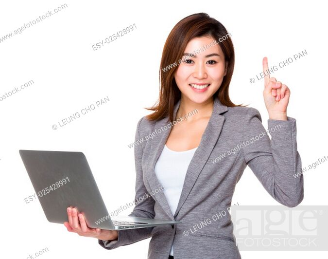 Stock Photo: Businesswoman hold with laptop and finger up.
