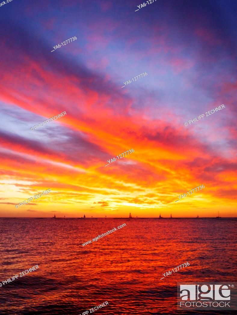 Stock Photo: Sunset over Waikiki, Hawaii.