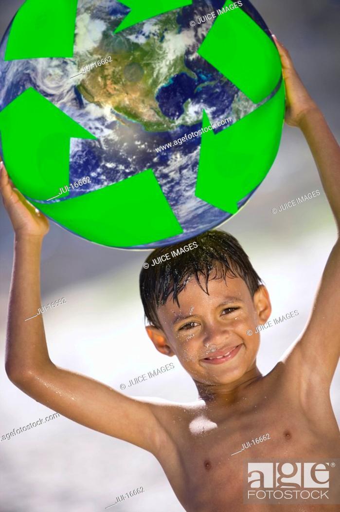 Stock Photo: Boy holding globe above head.