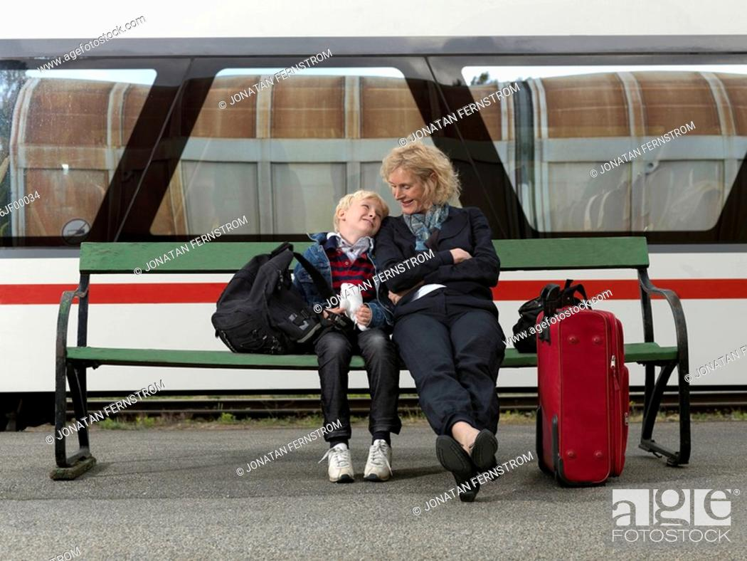 Stock Photo: Grandmother and grandson on train station.