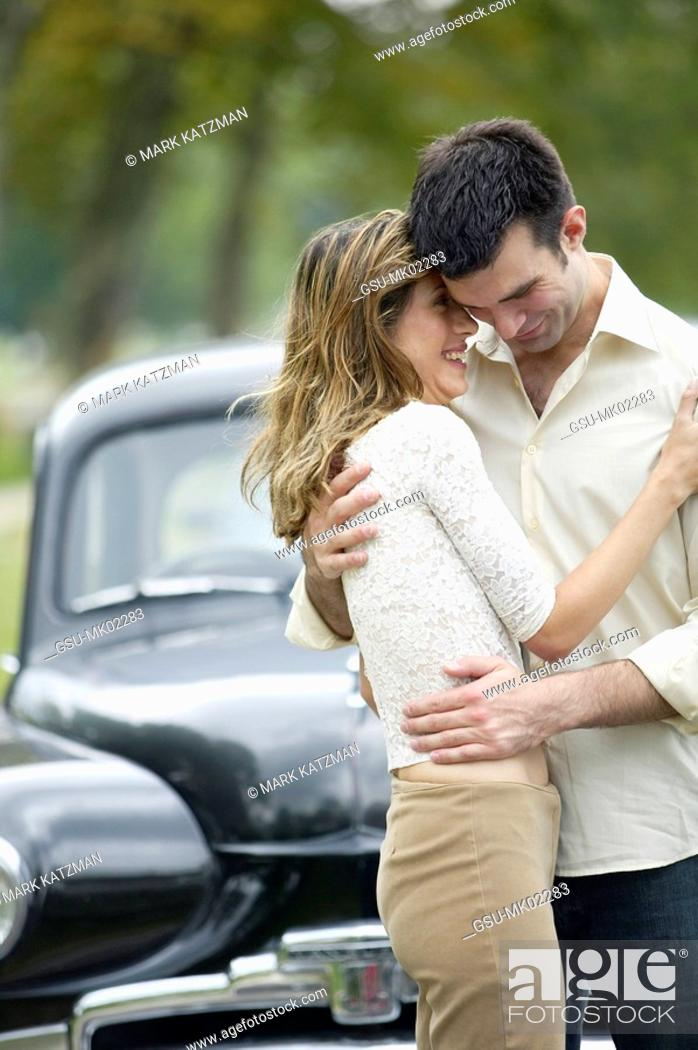Couple Embracing In Front Of Vintage Car Stock Photo Picture And Rights Managed Image Pic Gsu Mk02283 Agefotostock