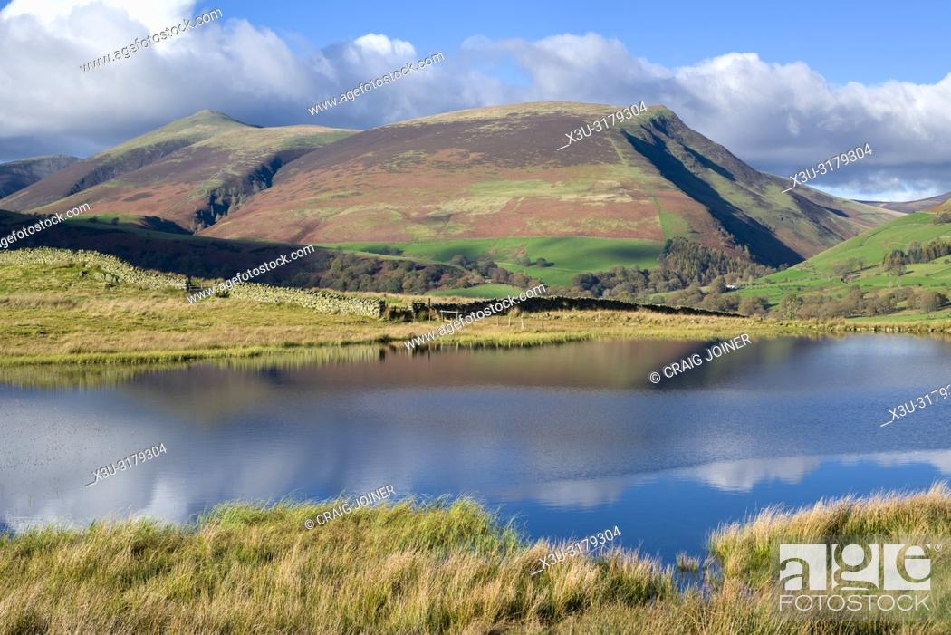 Stock Photo: Tewet Tarn and Lonscale Fell beyond in the English Lake District National Park, Cumbria, England.