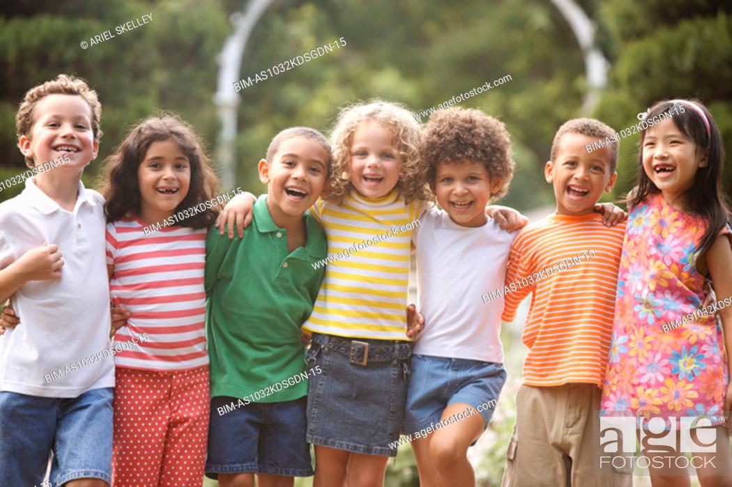 Stock Photo: Portrait of children arm in arm.