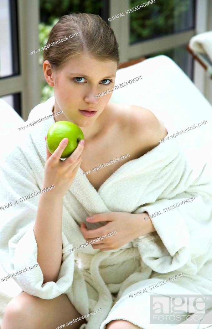 Stock Photo: Woman eating apple.