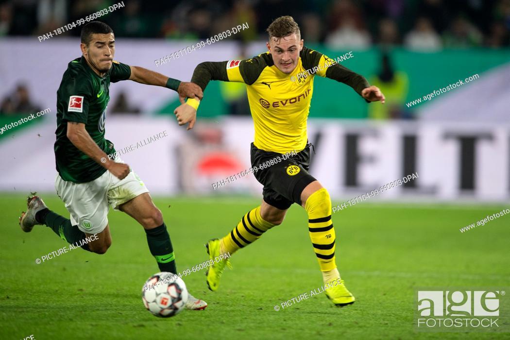 Stock Photo: 03 November 2018, Lower Saxony, Wolfsburg: Soccer: Bundesliga, 10th matchday, VfL Wolfsburg - Borussia Dortmund. Dortmund's Jacob Bruun Larsen (r) plays against.