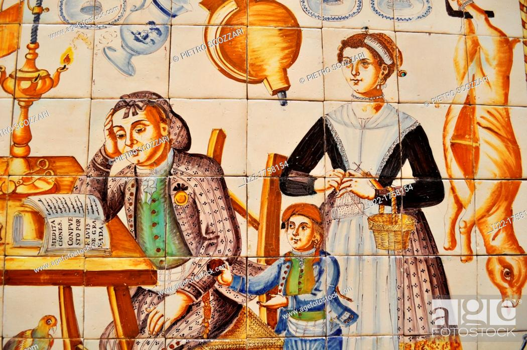 Stock Photo: Valencia, Spain: ceramic tiles depicting a traditional Spanish home scene at Museo Nacional de Cerámica y Artes Suntuarias González Martí.