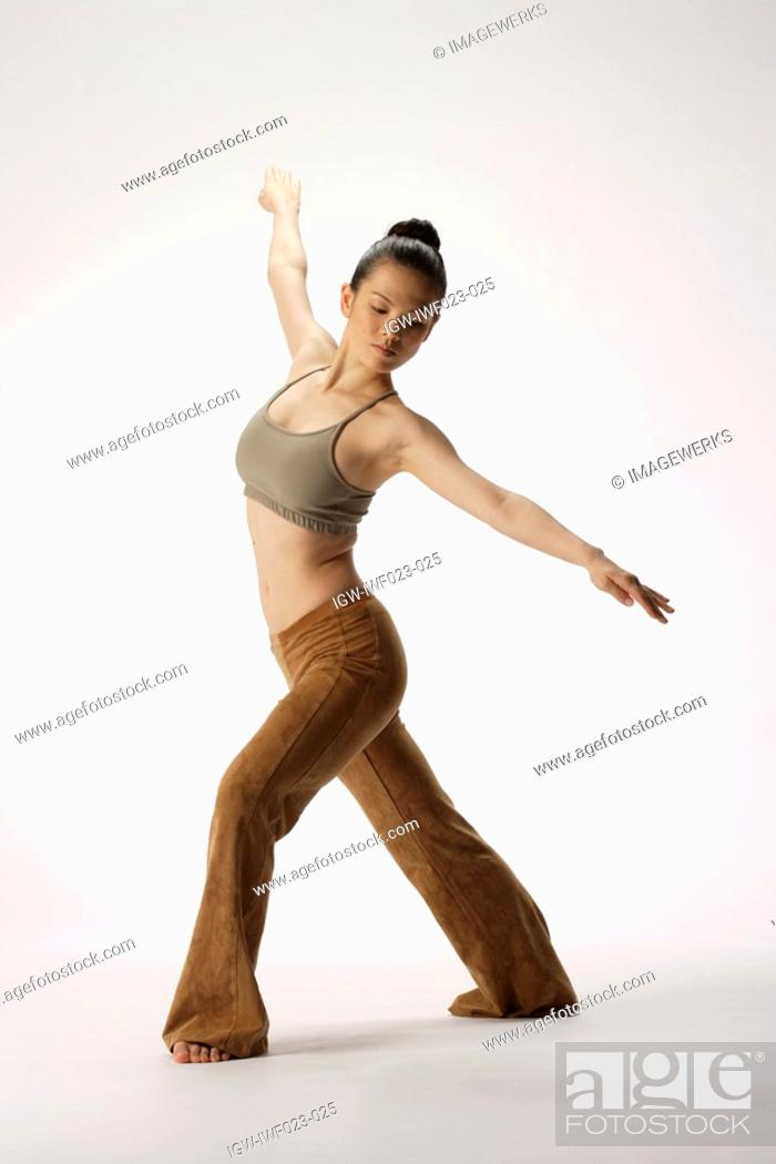 Stock Photo: View of a young woman stretching her body.