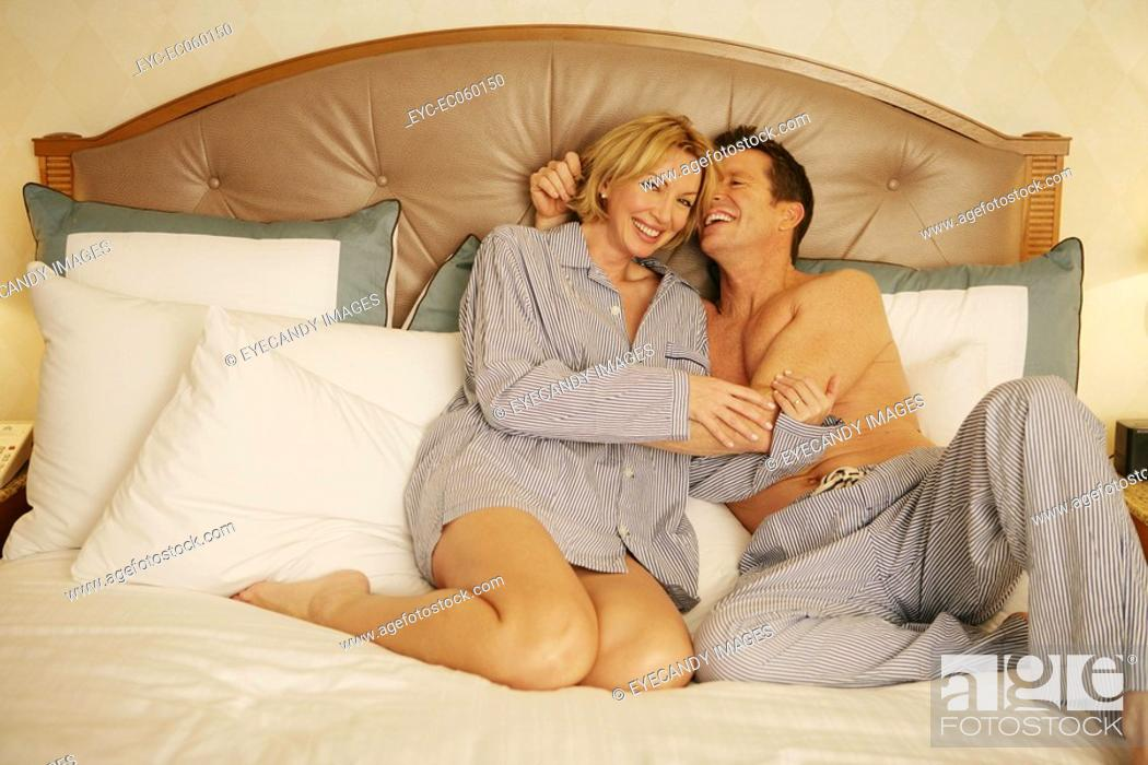 Stock Photo: Mature couple in bed in pajamas.