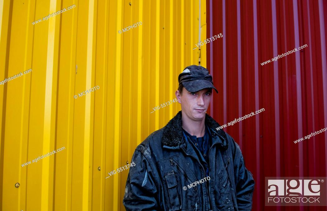 Stock Photo: Trucker portrait Lithuania improvements industry farming with colorful company of wheat farming storage area with trucks in Vaunas Lithuania - 01/10/2015.