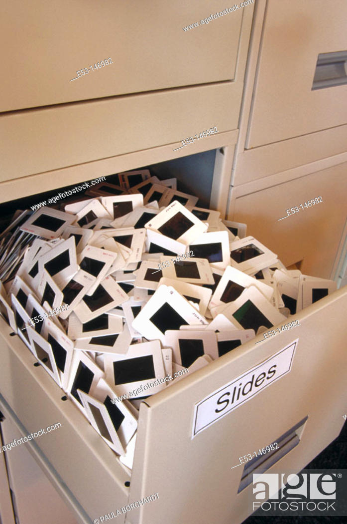 Stock Photo: File cabinet drawer crowded with 35 mm slides.
