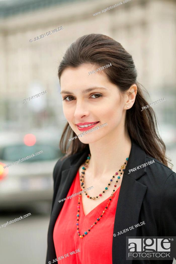 Stock Photo: Portrait of a beautiful woman smiling.