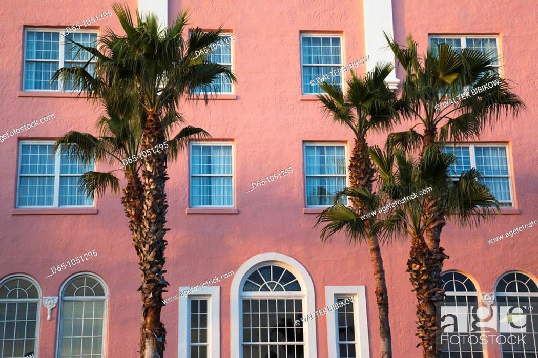 Stock Photo: USA, Florida, St  Petersburg Beach, palms and pink wall, Don Cesar resort hotel.