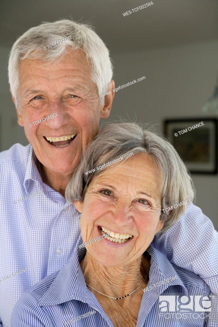 Stock Photo: Germany, Bavaria, Senior couple smiling, portrait.