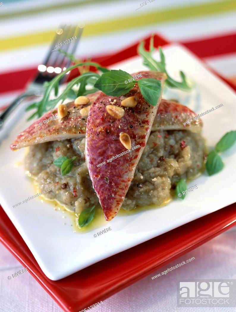 Stock Photo: Red mullet with eggplant caviar,pinenuts and basil.