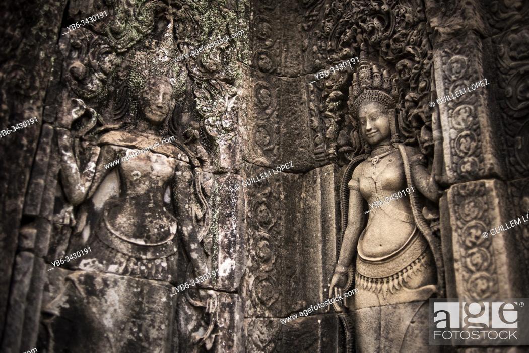 Stock Photo: Stone carved goddess at the walls of Bayon in Angkor Thom temple, Angkor Wat, Cambodia.
