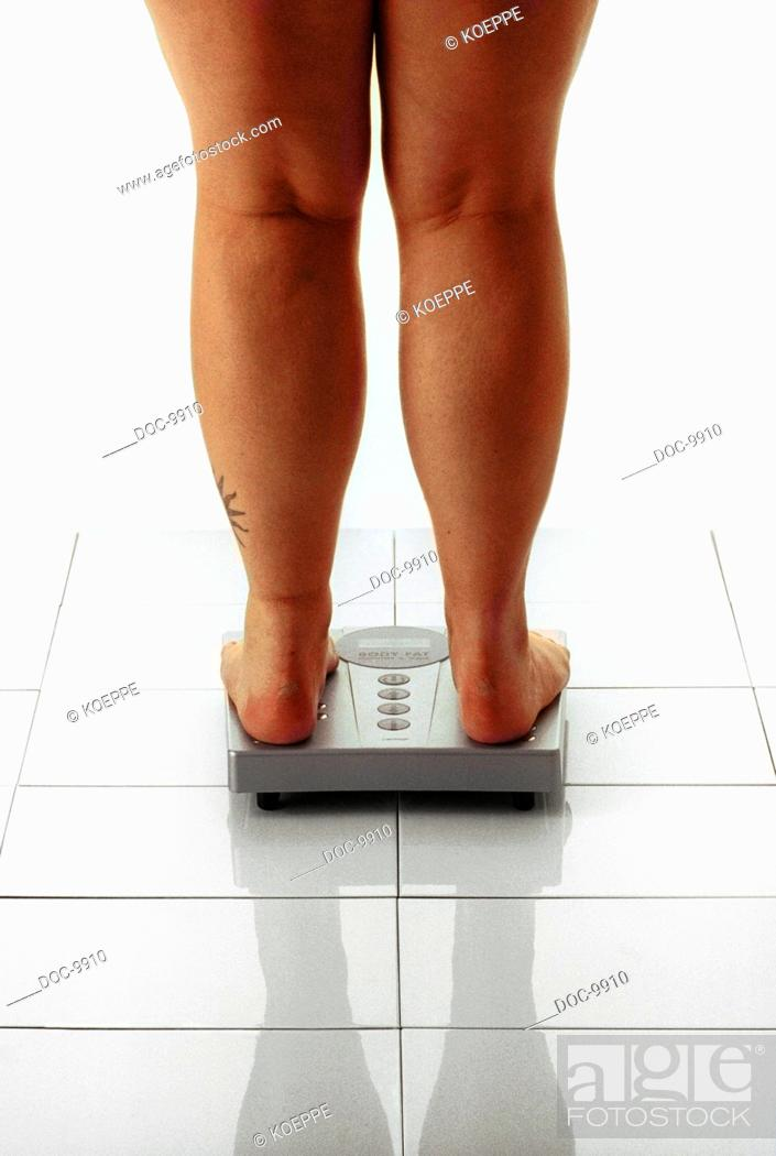 Stock Photo: Thick legs on some bathroom scales.