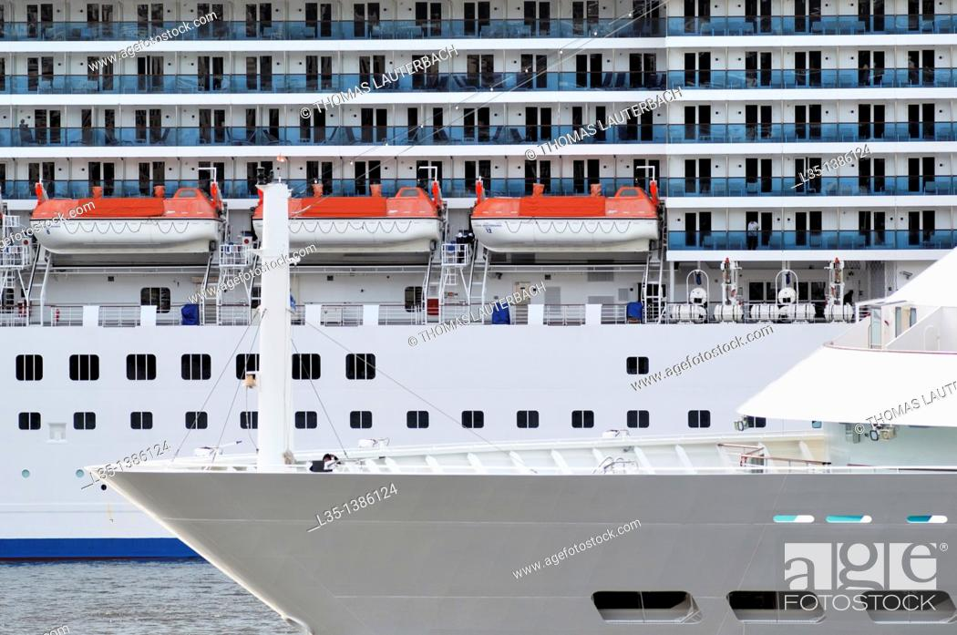 Stock Photo: Two cruise ships sail past each other tight, details.