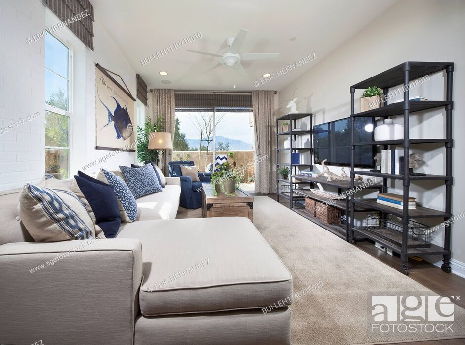 Stock Photo: Contemporary living room with furniture and shelves at home; Palm Desert; California; USA.