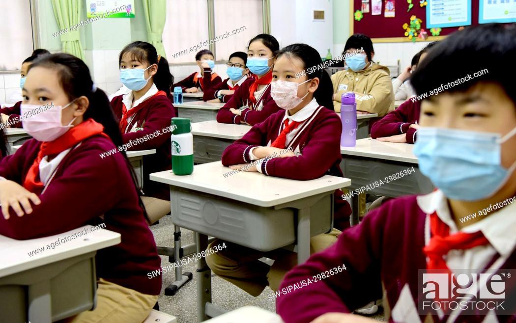 Stock Photo: (200511) -- ZHENGZHOU, May 11, 2020 (Xinhua) -- Pupils of five grade attend class at Weiyilu Primary School in Zhengzhou, central China's Henan Province, May 11.