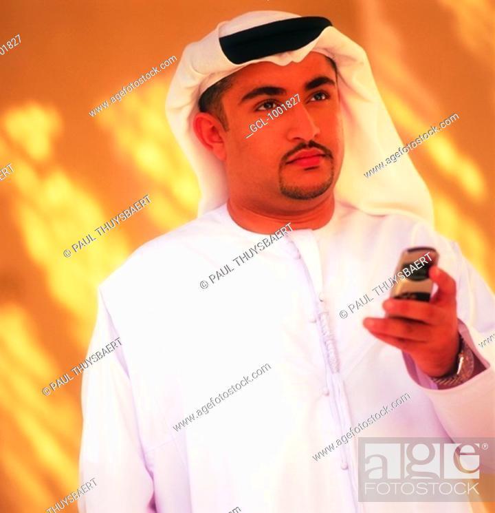 Stock Photo: Arab man holding a cell phone.