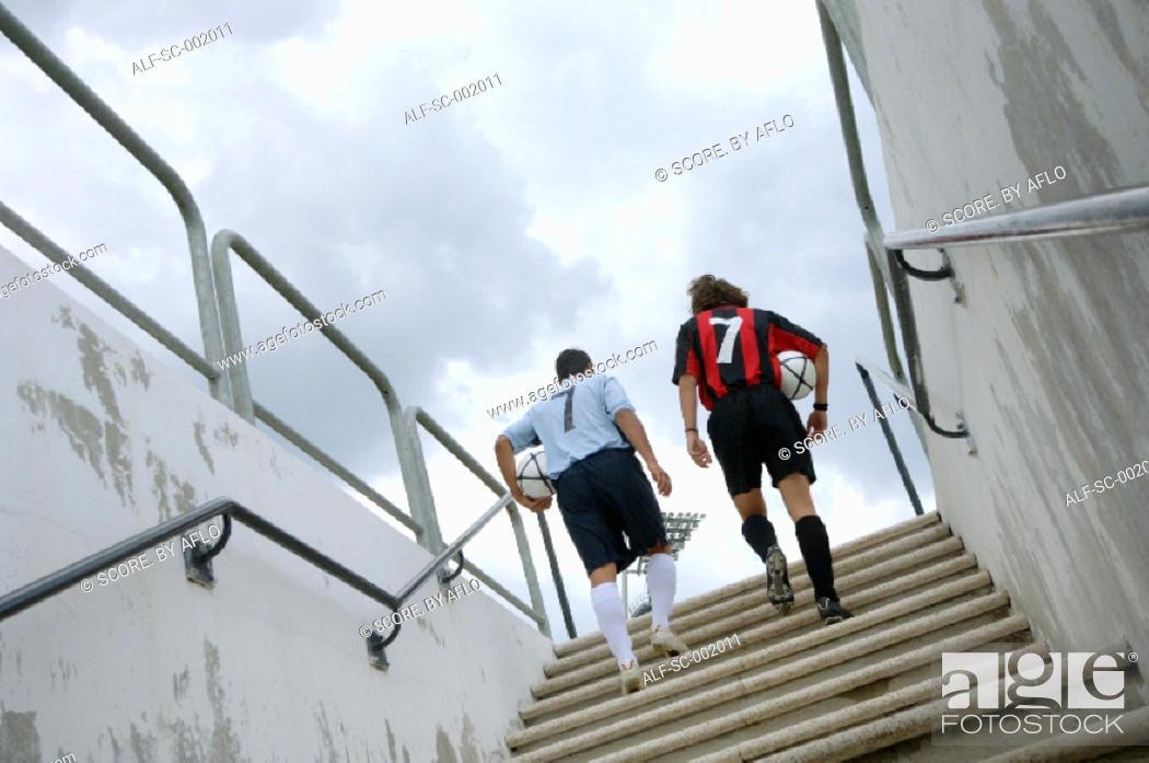 Stock Photo: Opponents climbing steps into stadium.