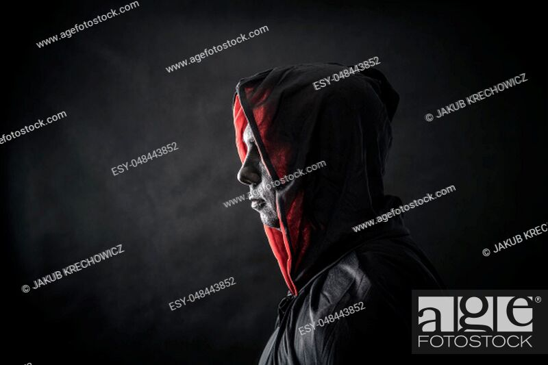 Stock Photo: Hooded man in the dark.