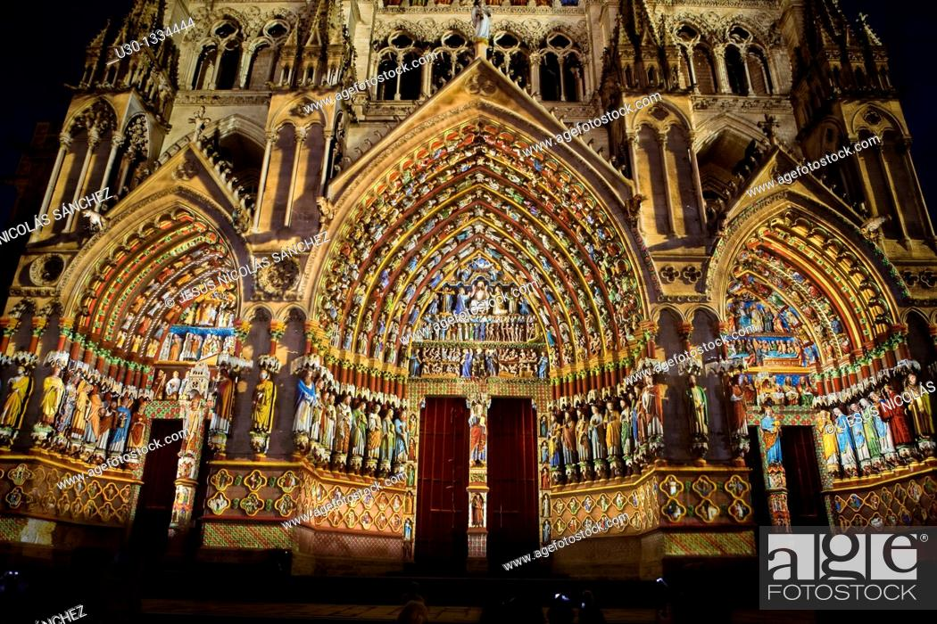 Stock Photo: Decorative lighting at night  Ornate doorway of the Cathedral of Notre Dame, from XIII Century, in Amiens listed as World Heritage by UNESCO  It's the Highest.