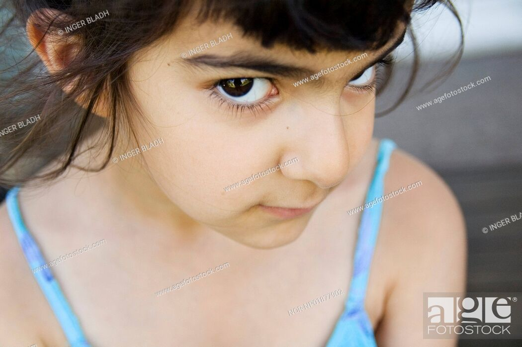 Stock Photo: Portrait of a girl looking into the camera.
