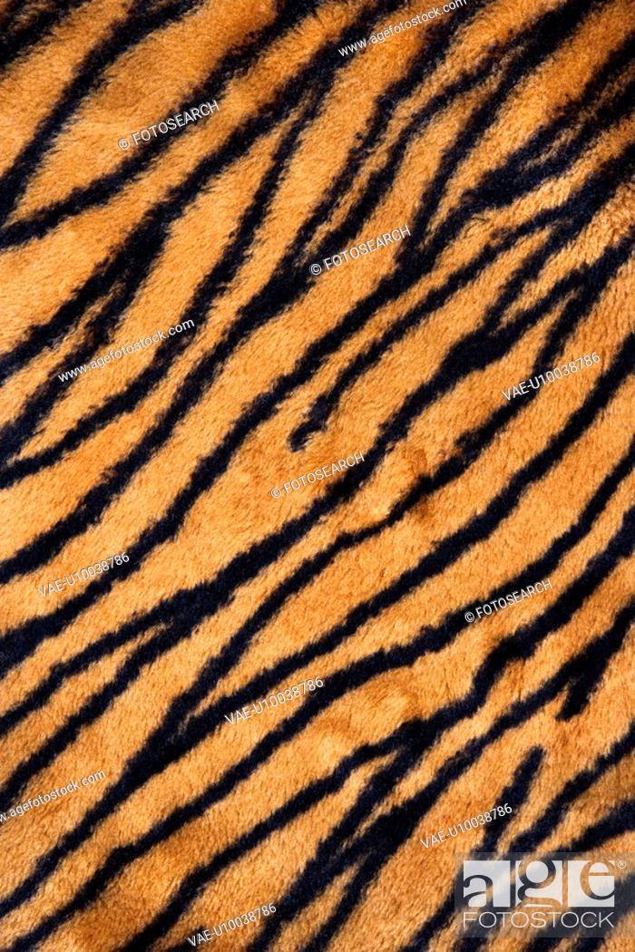Stock Photo: Close up shot of tiger print carpet.