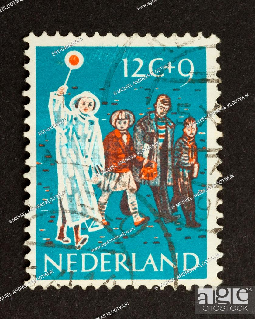 Stock Photo: HOLLAND - CIRCA 1950: Stamp printed in the Netherlands shows children and a woman in traffic , circa 1950.