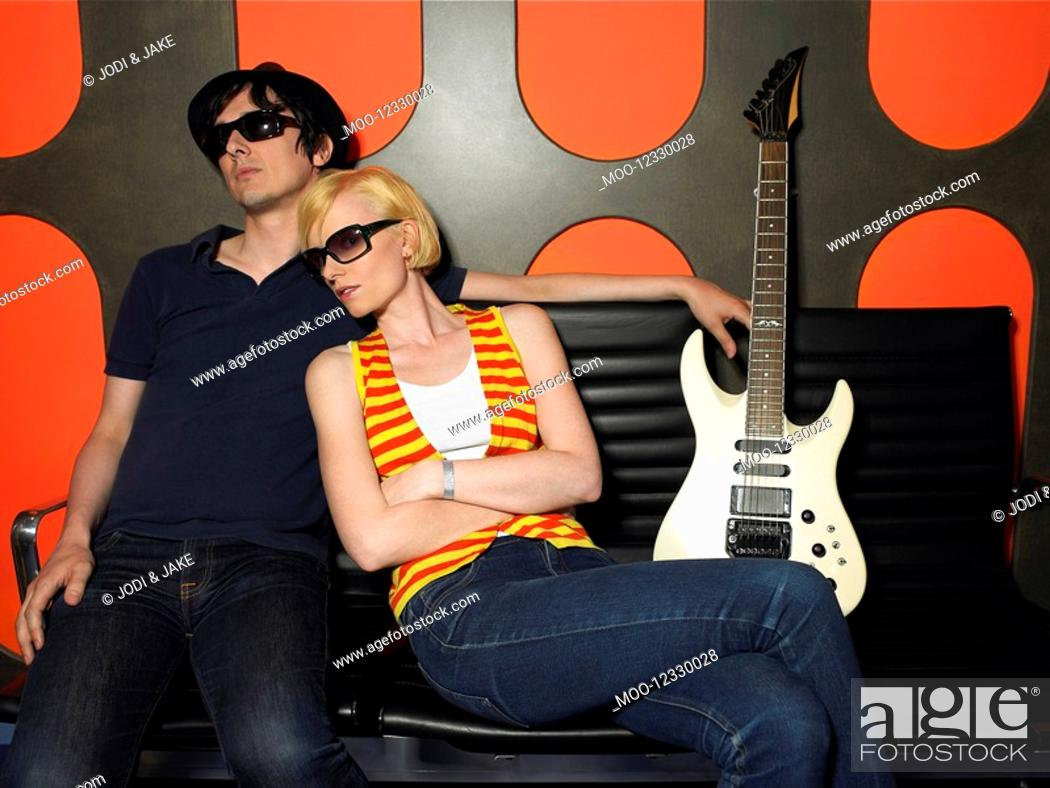 Stock Photo: Young couple with guitar portrait.