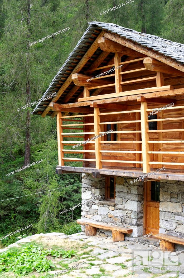 Stock Photo: A restored alpine home made of local stone and wood, while the roof is covered by slate flat stones. Valsesia. Pennine Alps. Piedmont. Italy.