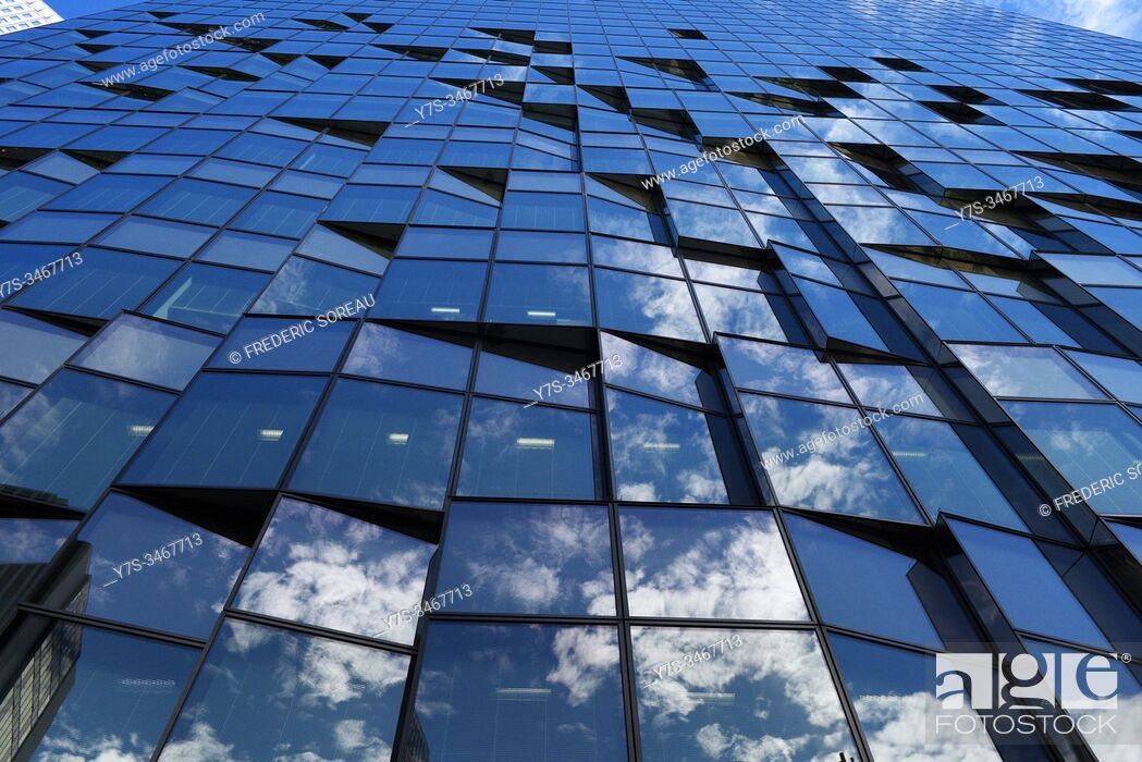Stock Photo: View of reflections in the glass windows of a building in Osaka, Honshu, Japan, Asia.