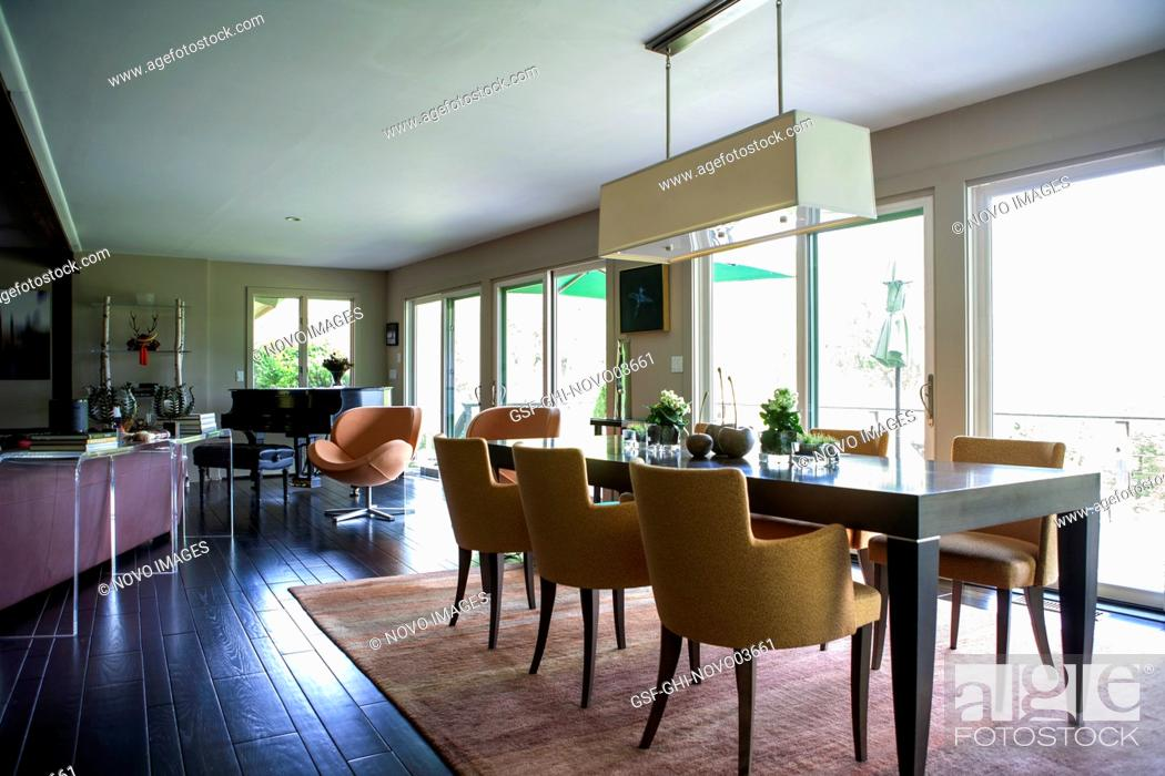 Stock Photo: Dining Table and Piano in Residential Home.
