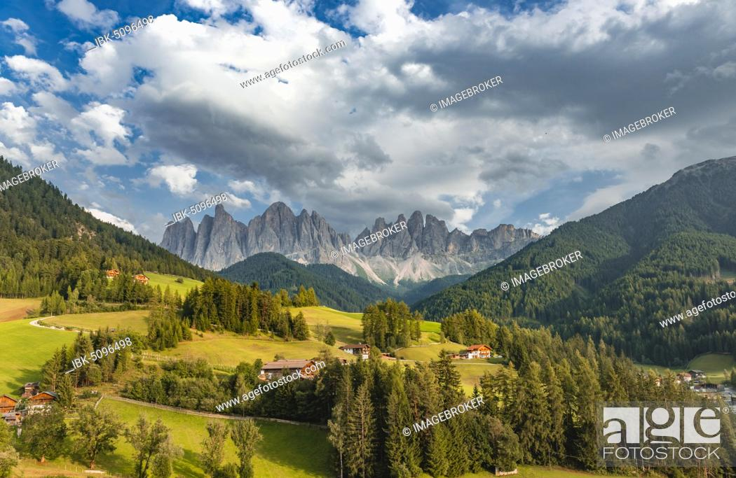 Stock Photo: Church of St. Magdalena and Felder, Villnößtal, in the back Geislergruppe with Sass Rigais, St. Magdalena, Bozen, South Tyrol, Italy, Europe.