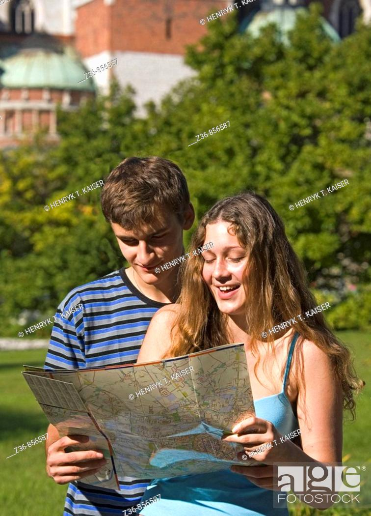 Stock Photo: Poland Krakow, Couple with city map by Wawel Castle.