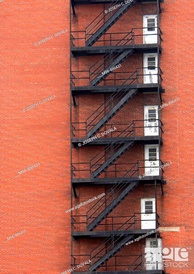 Stock Photo: Fire escape doors brick building.