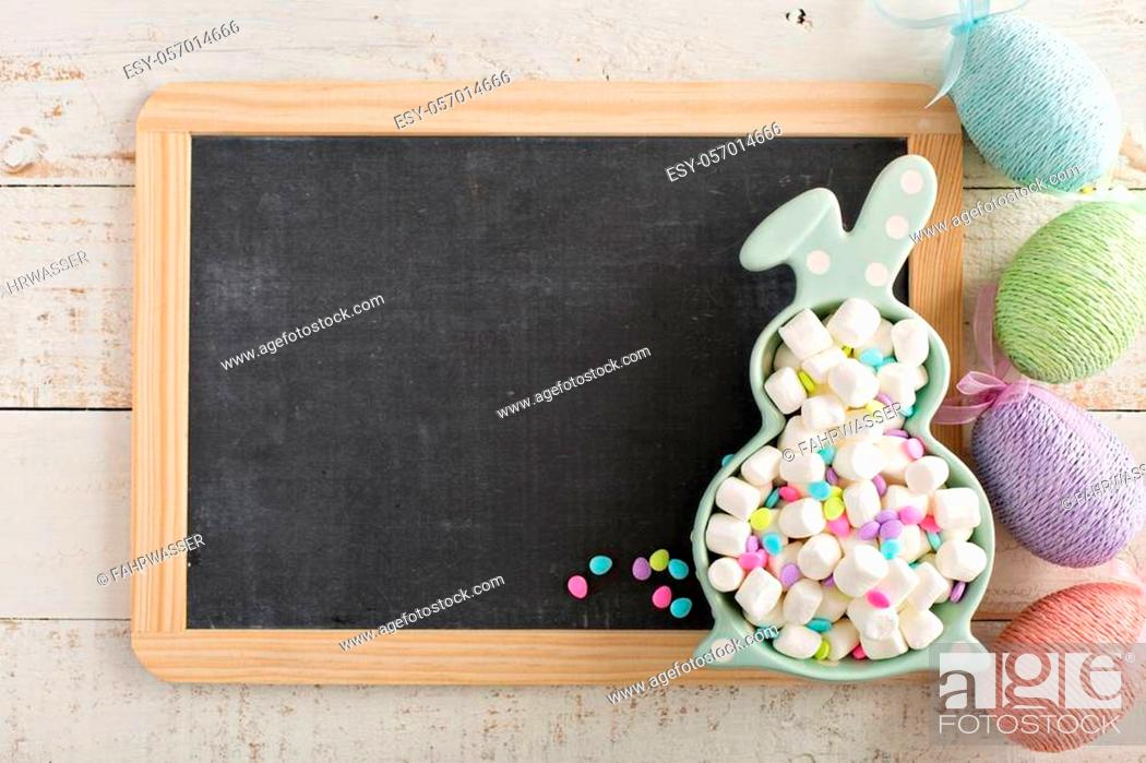 Stock Photo: Easter background with mini marshmallows in bunny plate.
