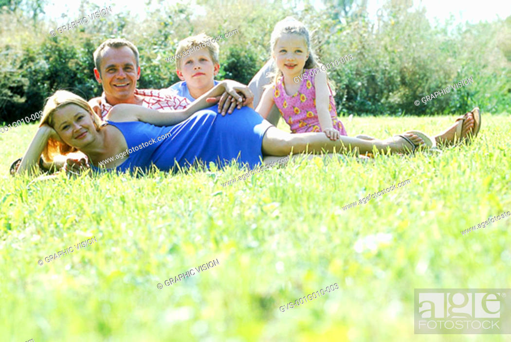 Stock Photo: Portrait of a family in park.