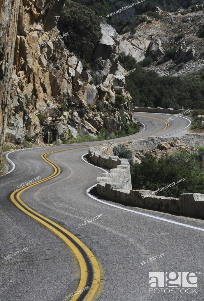 Stock Photo: Winding mountain road that is the route thru Kings Canyon California, in the Sierra Nevada Mts.
