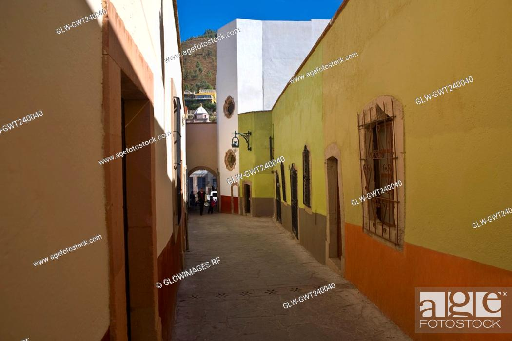 Stock Photo: Empty alley in a city, Callejon De Veyna, Alcaiceria De Gomez, Zacatecas State, Mexico.