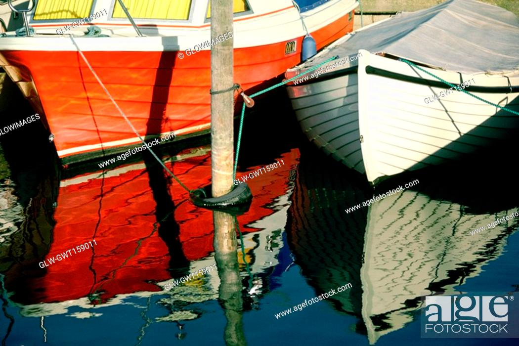 Stock Photo: Two boats docked at the harbor, Funen County, Denmark.