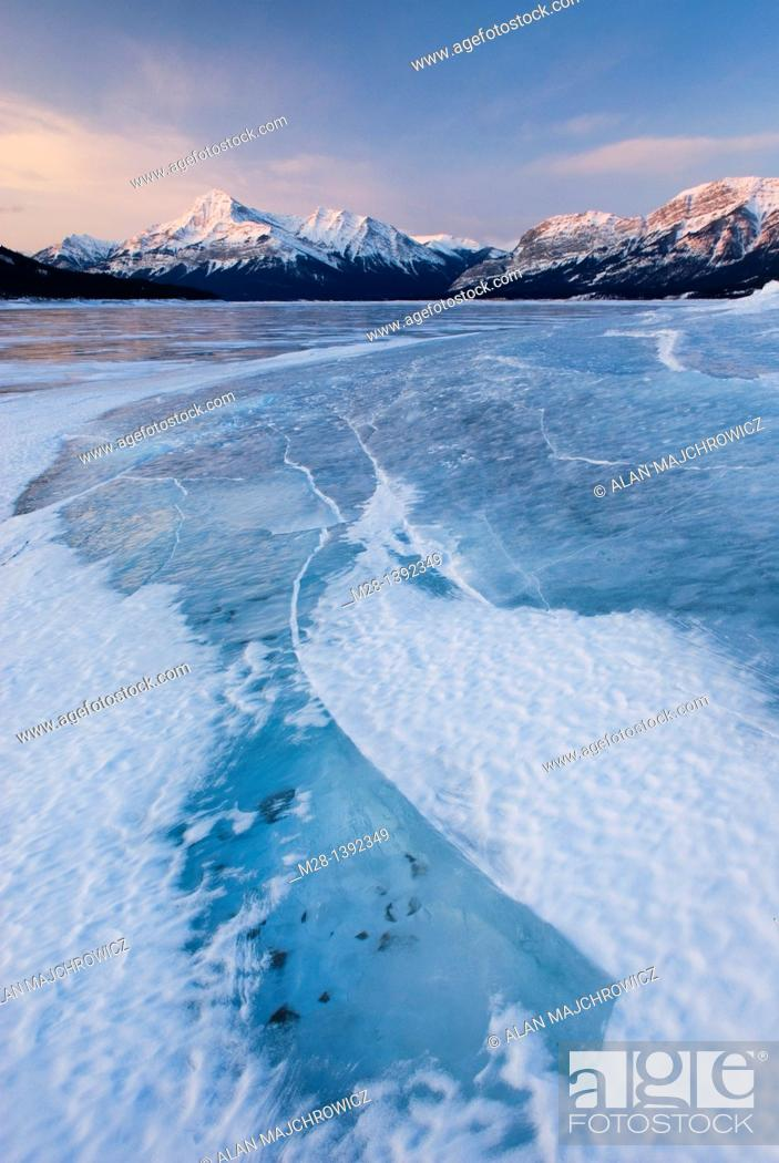 Stock Photo: Daybreak over the wind blasted surface of Abraham Lake, Alberta Canada.