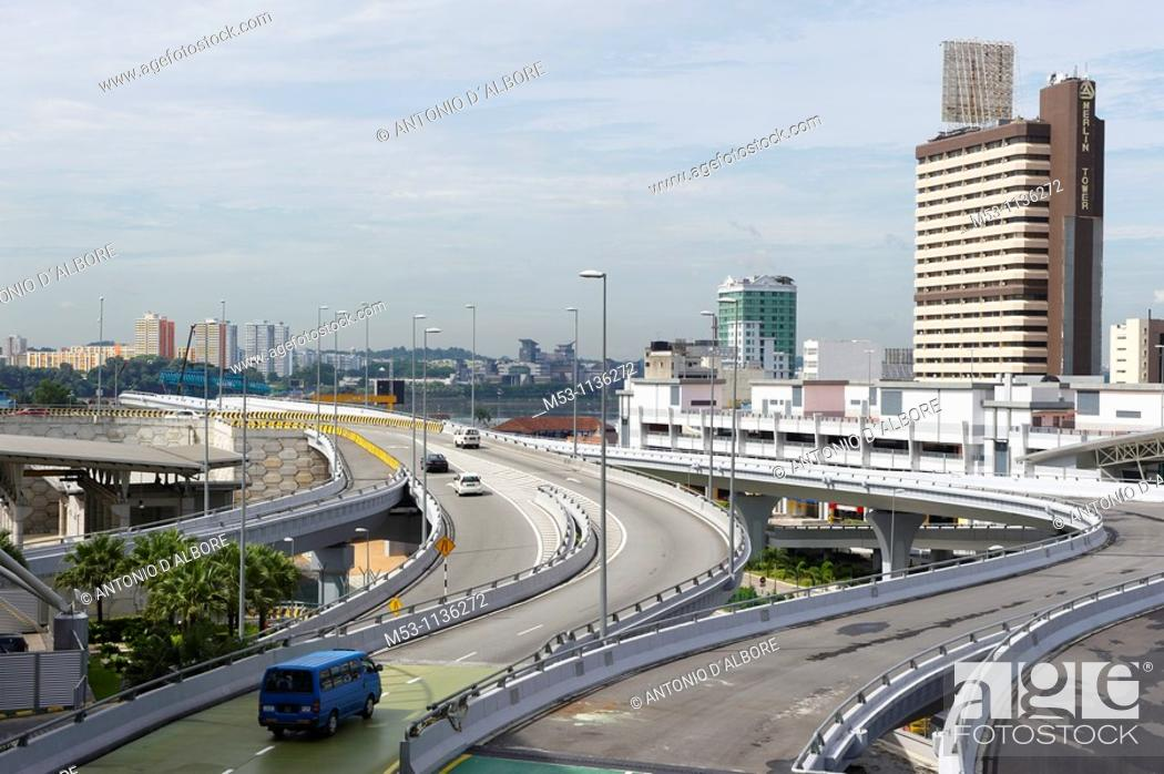 Stock Photo: Elevated roads heading to the border with Singapore in Johor Bahru The coloured buildings in the far background is Woodland town in Singapore Johor Malaysia.