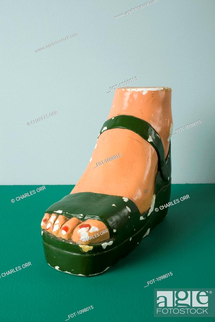 Stock Photo: A retro female mannequin's foot wearing a sandal.