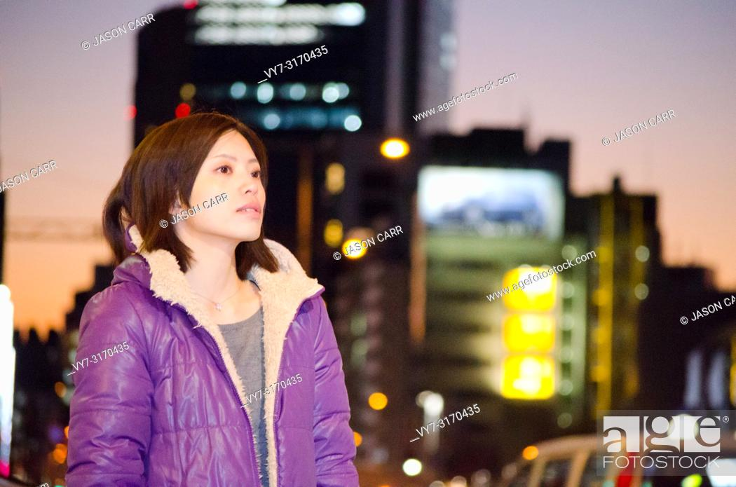 Stock Photo: Japanese Girl poses on the street in Aoyama, Japan. Aoyama is a famous area about universities in Tokyo.