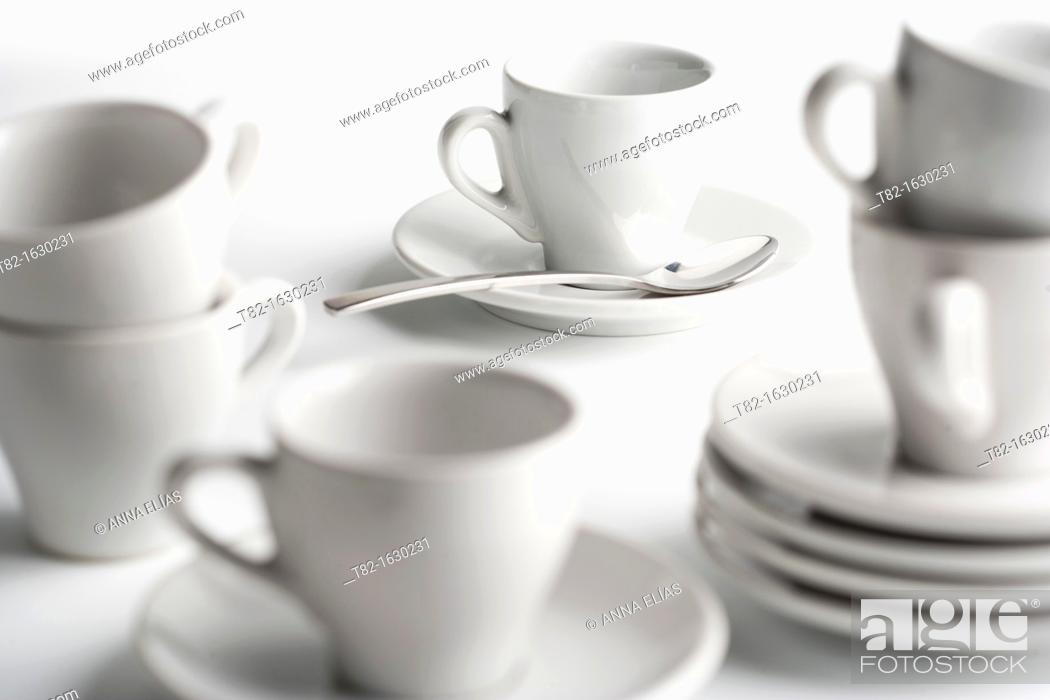 Stock Photo: coffee cups and saucers of white on white porcelain.
